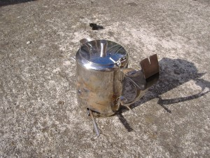 A teapot with tools welded on, holes have been blown at some weld sites