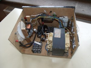 The power supply with the side and top of the case removed to show all the internal changes