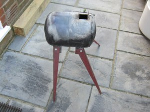 The burner with the rear legs adjusted to provide more support to prevent backwards toppling