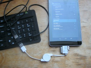 The lead being used to connect a keyboard to my Nexus 7, with the keyboard configuration screen open