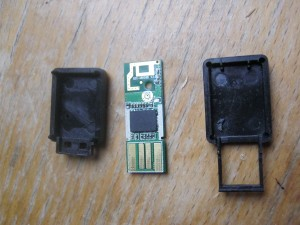 The two case sections and the circuit board that comprise the dongle