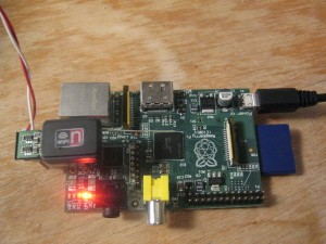 The modified dongle plugged into the top USB port of a Raspberry pi