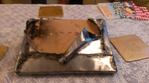 The steel envelope, significantly torn open, but not enough to allow the card to be removed