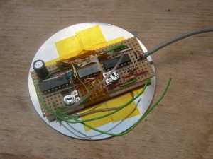 The circuit board, now glued in place on the back of the platter