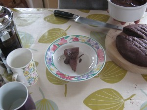 A slice of hello world cake, served with chocolate sauce